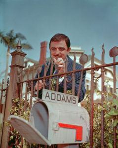 John Astin (Gomez), standing in front of 21 Chester Place